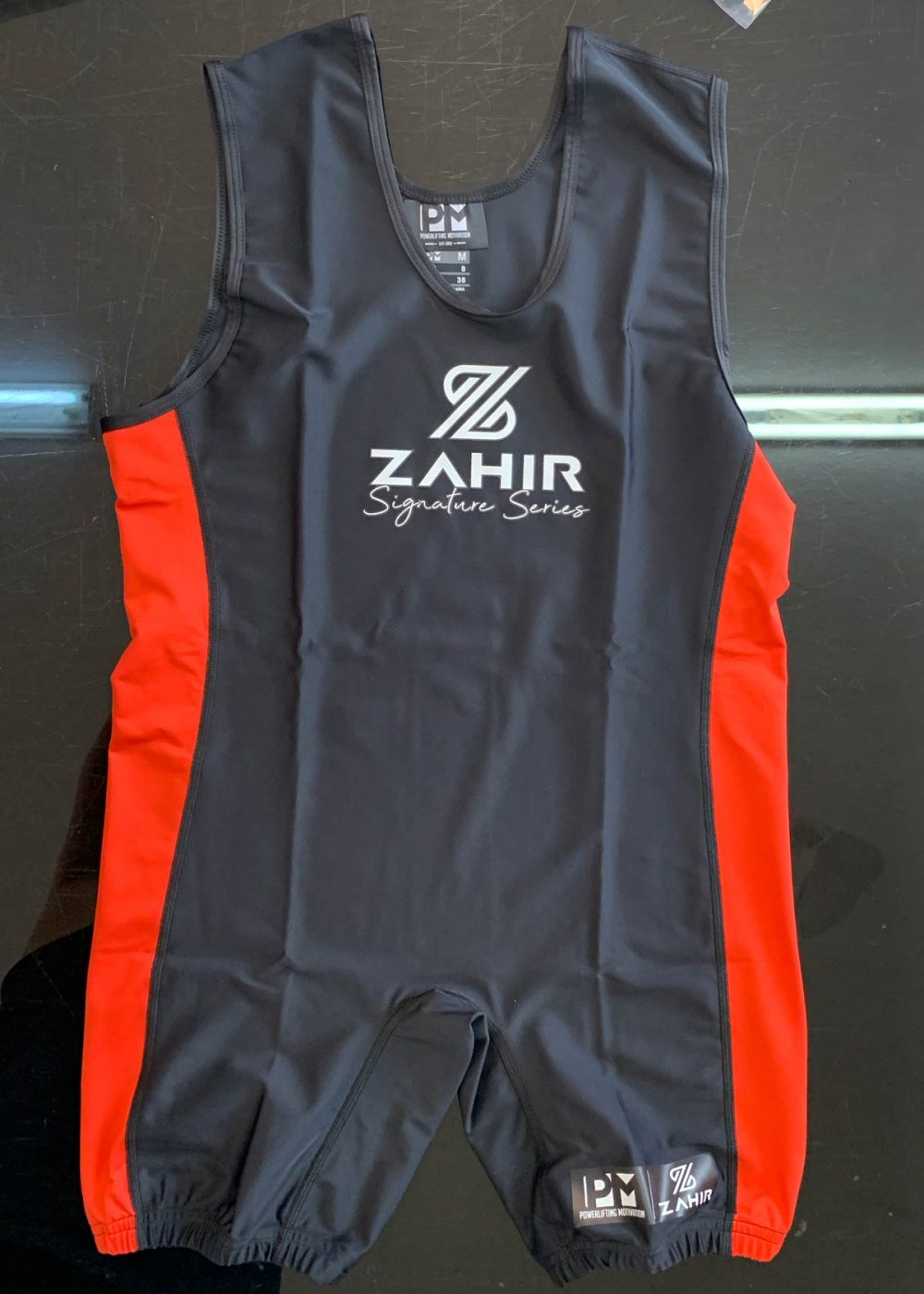 pm-zahir-singlet-front-1-web