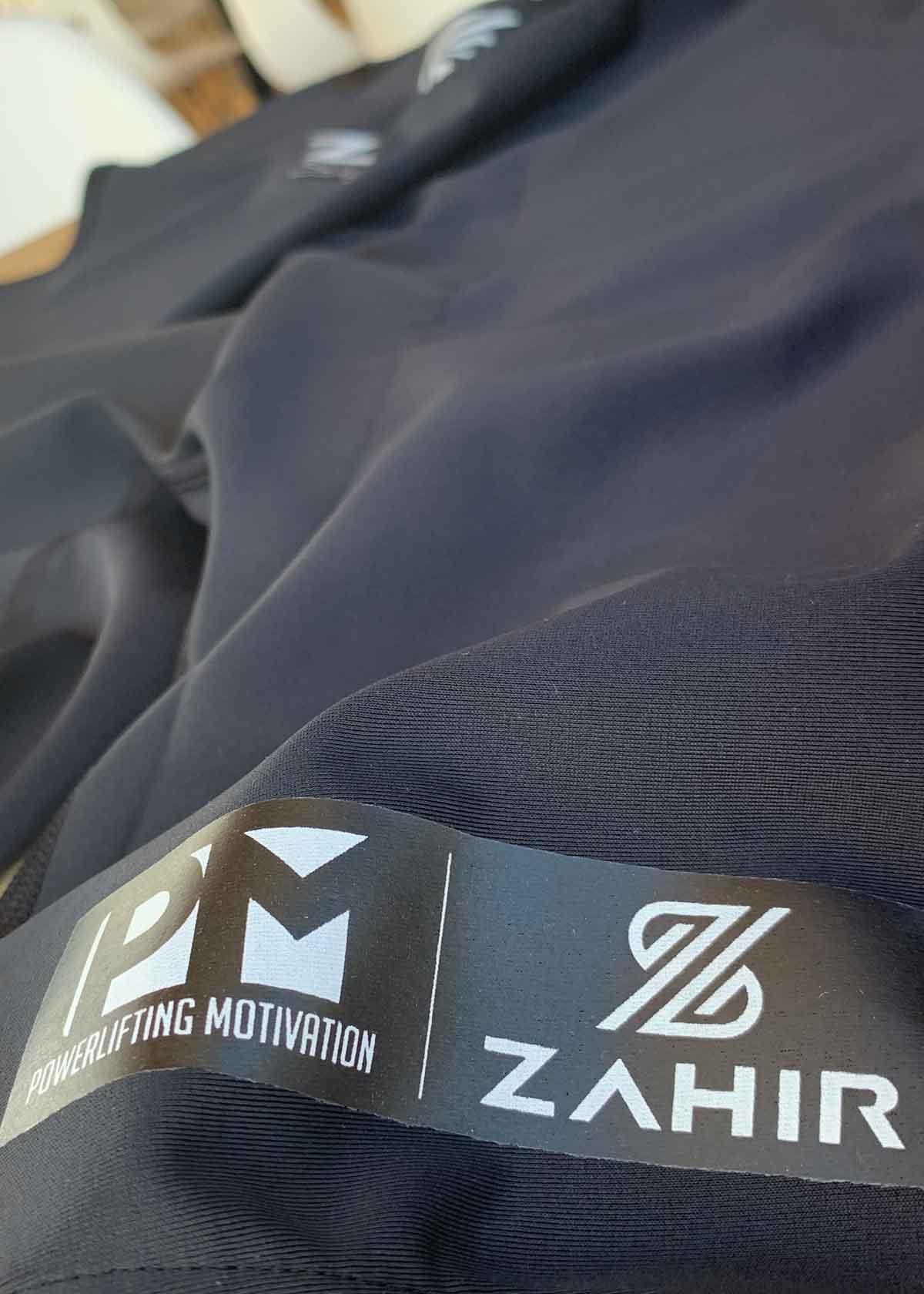 pm-zahir-singlet-logos-web